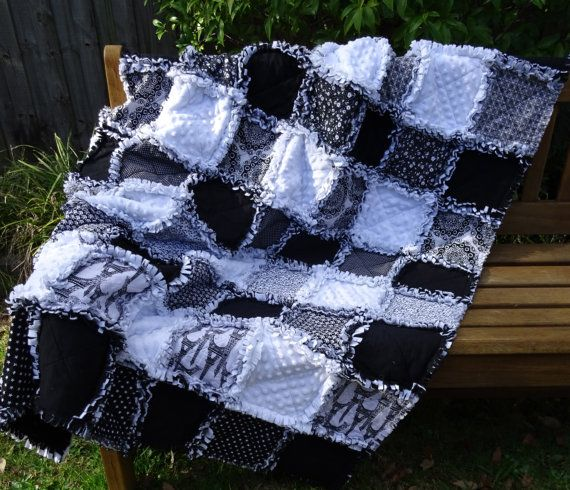Warm and snuggly reversible black and white rag quilt/throw rug