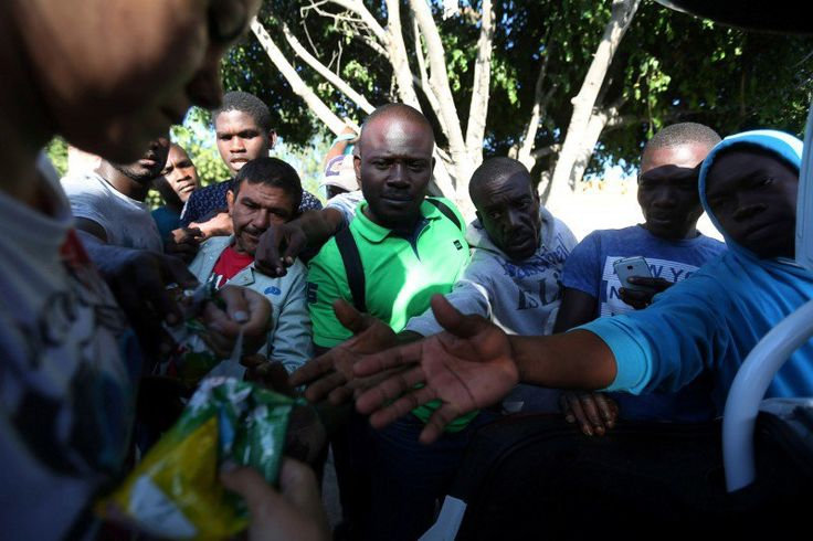 Haitian migrants ask for food outside Padre Chava shelter after leaving Brazil, where they sought refuge after Haiti's 2010 earthquake, but are now attempting to enter the U.S., in Tijuana, Mexico, October 3, 2016. Picture taken October 3, 2016. REUTERS/Edgard Garrido