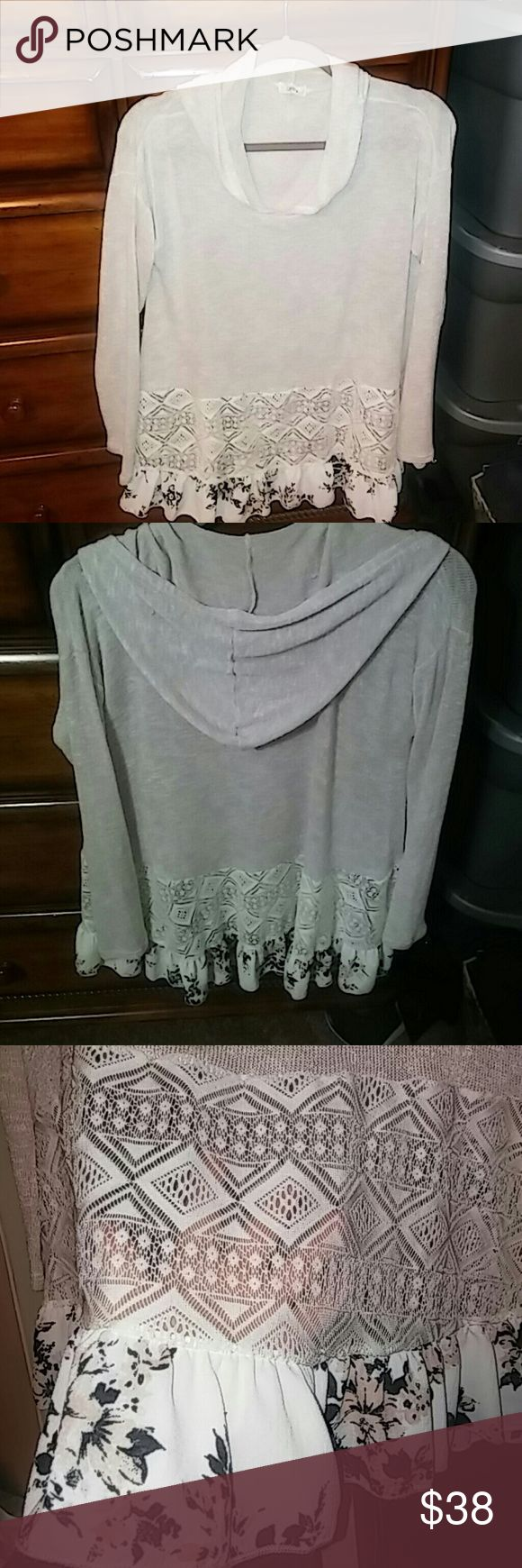 Boutique hooded sweater with lace & chiffon hem This is such an adorable tunic style sweater that is super soft to the touch and feels so good on. Looks best with leggings or jeans. It's thin so hot should wear a cami or tank under it but lays beautifully on the body. It's too long for me because I'm very short but if you want to wear as a dress with boots & tights if short it would look great just not my style so it's been hanging in the closet! Colors are black & pale pink on bottom…