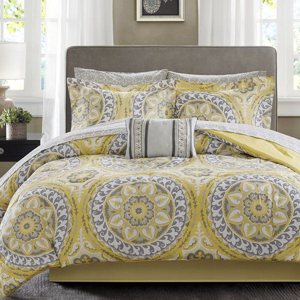 For a modern update to your space, this Quilt/Coverlet Set can provide a whole new look with warm colors. An intricate medallion pattern repeats across the top of bed with shades of color playing up this oversized print. An oblong pillow uses decorative embroidery and piecing to create texture on the top of bed while 180 thread count cotton sheets feature a medallion print to complete this look.