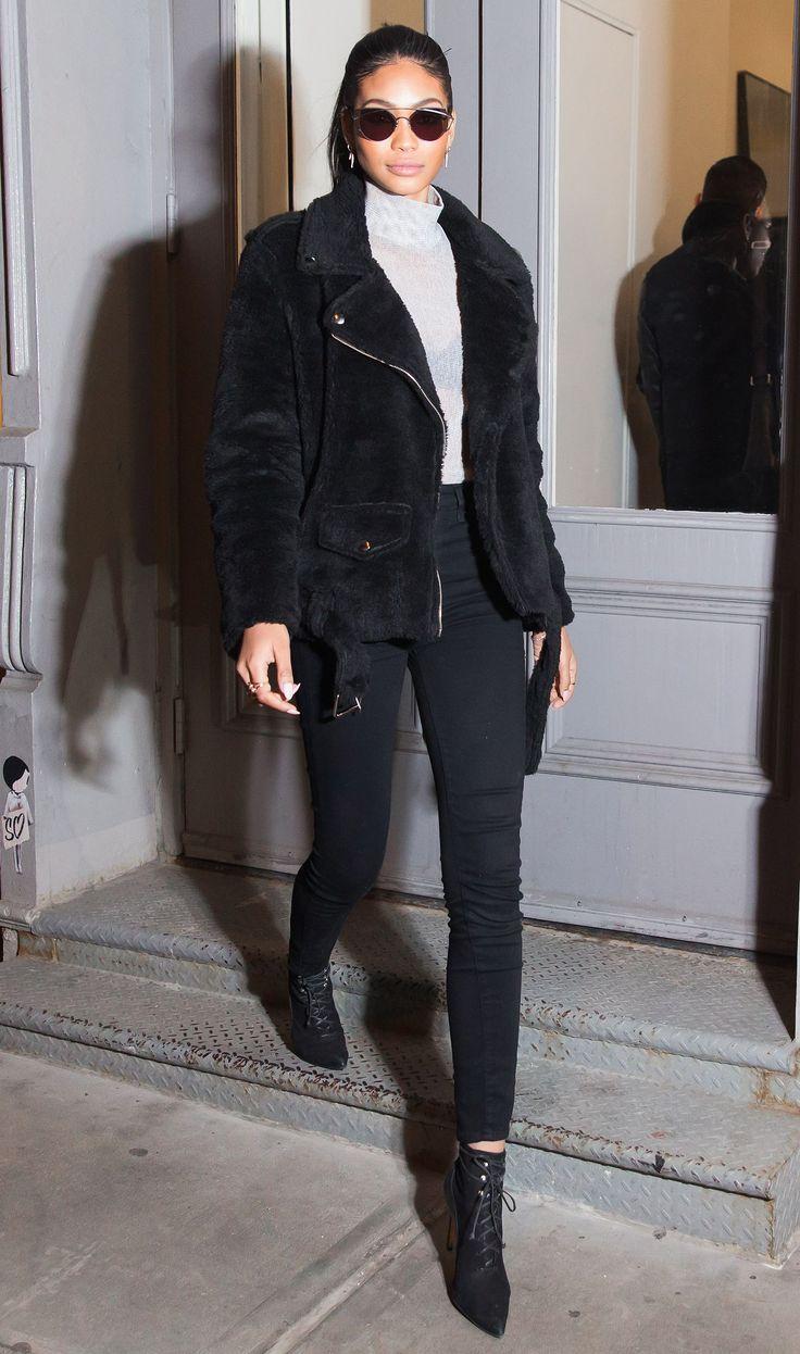 black fur motorcycle jacket + gray turtleneck + black skinny jeans + black booties