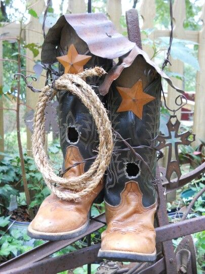 Pair of old cowboy boots repurposed into birdhouses, with a rusty tin roof. Check out my other boot birdhouses @ Peedledums Primitives !!!!