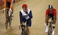 Britain's Chris Hoy (C) celebrates after the track cycling men's keirin second round at the Velodrome during the London 2012 Olympic Games August 7, 2012. REUTERS/Paul Hanna