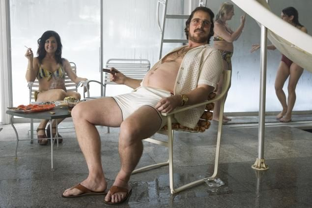 Irving Rosenfeld (Christian Bale) at a pool party in Columbia Pictures' 'American Hustle.' (Reminded me of The Sting...) incredible job by Christian Bale