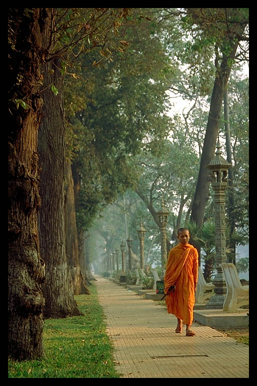 A #Buddhist #monk walking alone | #Cambodia