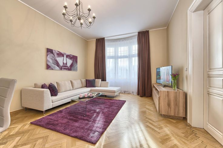 Beautiful living room designed in shades of purple and brown - Maiselova 5 Apartments, Prague