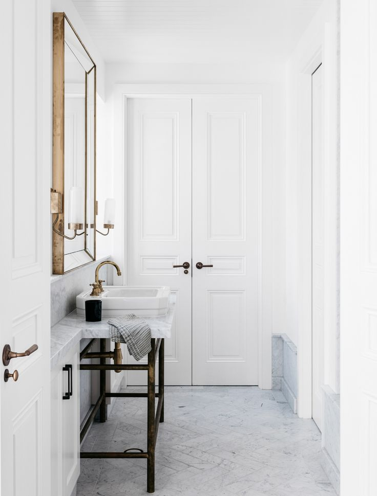 Classic bathroom in a Sydney vacation home by Alexander & Co. | Photo by Felix Forest