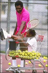 A young Venus Williams in a shopping cart of tennis balls with her dad Richard Williams.