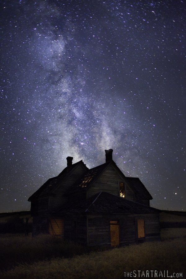 glowing house under stars at night 3