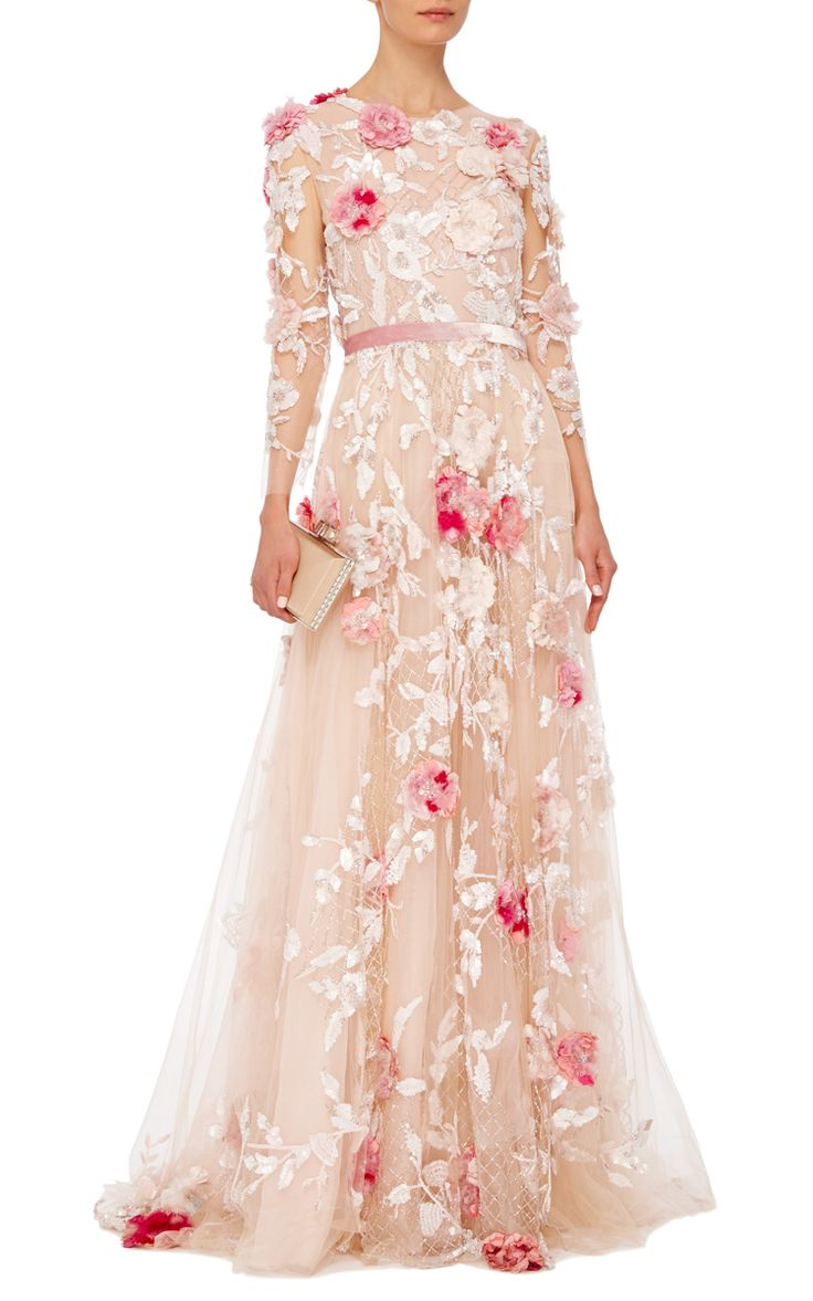 This **Marchesa** gown features long sleeves and 3D feather flower embroidery.