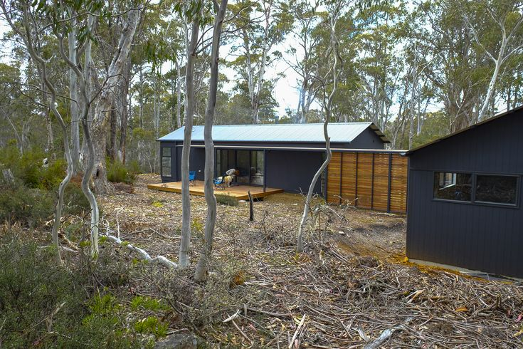 JAWS' MAKO Modular Homes- Highland Waters House, Tasmania. When dreaming of their Central Highland's shack the owners of this property wanted a small building with one bedroom with the flexibility to be expanded to a two bedroom when required.  JAWS solution for this Highland Waters shack has provided a cost- effective, low impact and environmentally friendly building, built efficiently in the smallest footprint possible.