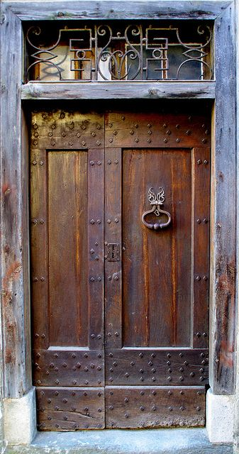 I like the idea of framing a door with nail studded rustic trim.  Siguer (Ariège) France