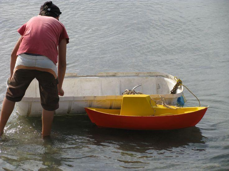 a boy, a boat and a toy! winter 2011 Pefki-Evia photo by maria koulouri