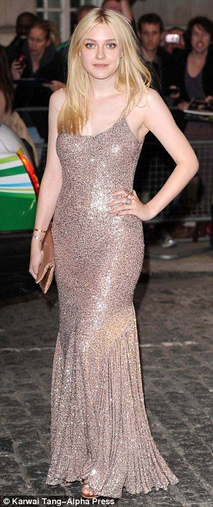 Looking good: Dakota Fanning arrives at the London premiere of Now Is Good wearing a slinky sequin dress