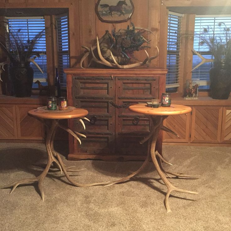 A set of Home made Elk Tables with round wooden tables. Elk Horns are authentic. Great for end tables or just decorations.