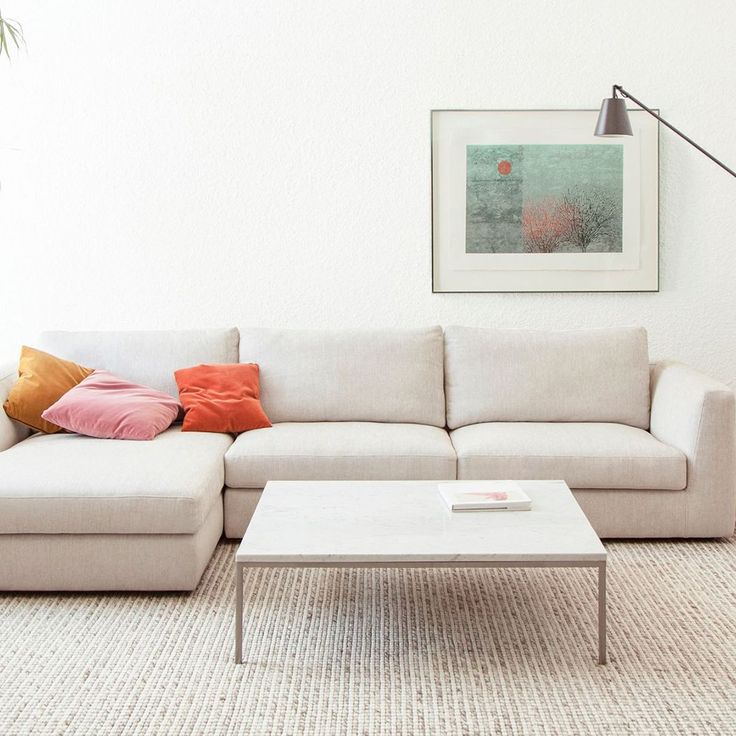 We love this simple cream sectional, it's a great versatile piece to decorate around!