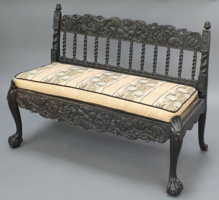 """Lot 1021, A 19th Century Anglo Indian carved hardwood hall bench with spiral turned decoration, heavily carved throughout and raised on cabriole supports 30""""h x 40""""w x 18"""" est £190-220"""