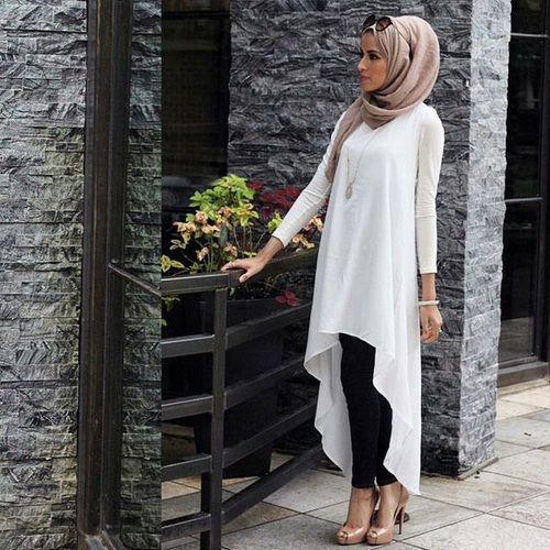 http://geoarabica.blogspot.com/  I love this hijab look. The white shirt with a long-draping back gives it an edgy look with the modesty of a faux-baya.  FROM TASNEEM HEMA