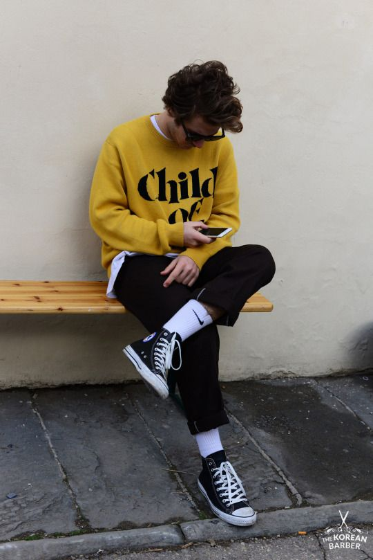 Yellow Type Jumper, White T, Black Pants, White Nike Socks, Black Converse.