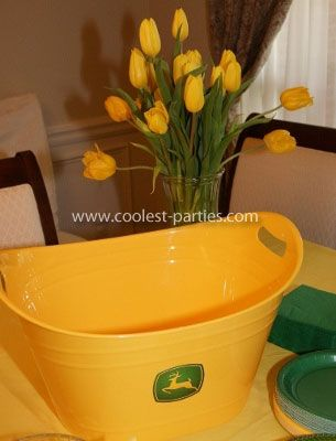 Yellow tub from wal-mart with John Deere sticker on front - good for drinks or wrapped utensils.