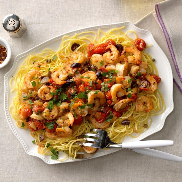 Shrimp Puttanesca Recipe -I throw together these bold ingredients for a feisty seafood pasta. —Lynda Balslev, Sausalito, California