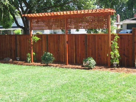 Easy trellis to add privacy to backyard along fence line.  Would bring lattice down further to close off gap.