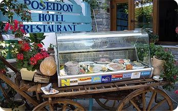 """Restaurant Poseidon the traditional Greek family restaurant of Kokkari is named after the god of the sea """"Poseidon"""" or """"Neptune"""" and offers the widest variety of Samos and seafood recipe dishes."""