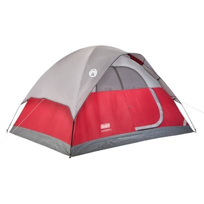 You and your backpacking partners will sleep protected from the weather inside a Coleman Flatwoods II 4-Person Tent.