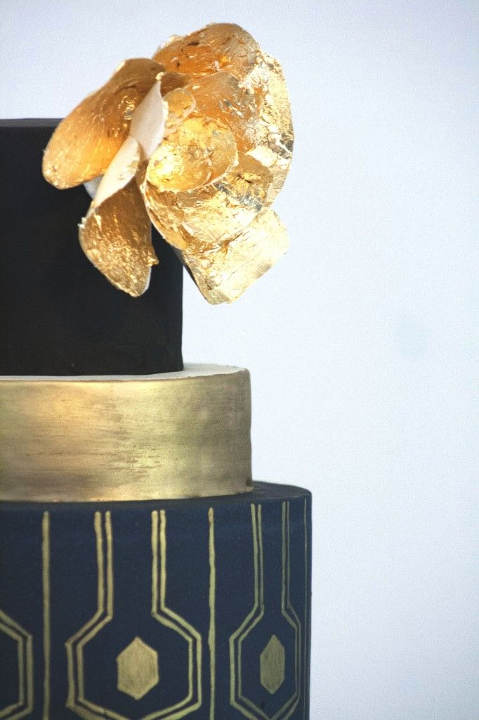 Glamorous black and gold art deco wedding cake