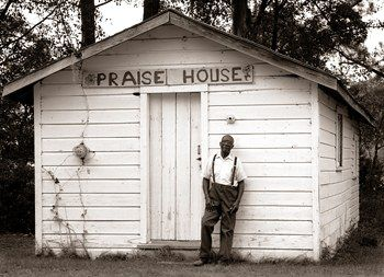 """A Gullah """"praise house,"""" a surviving example of slaves' secret meeting places, and its pastor, Rev. Henderson; St. Helena Island, South Carolina, 1995"""