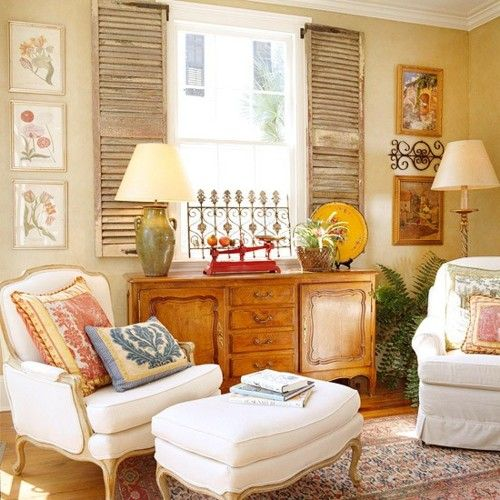 French country style with shutters, antique buffet and bergere chair and ottoman....