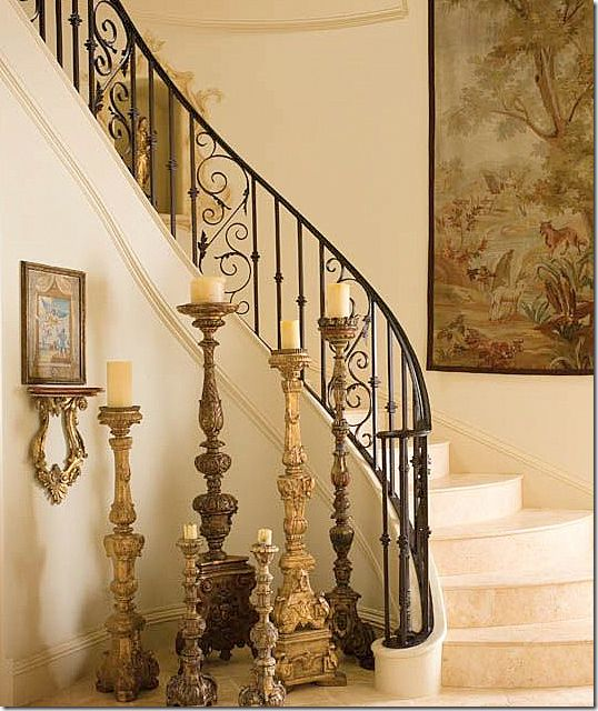 a limestone staircase and an antique tapestry   ...to say nothing of the candlesticks.