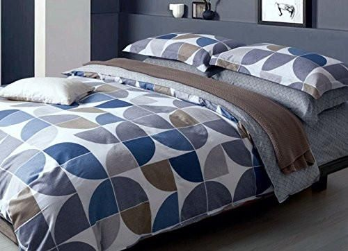 Modern Scandinavian style geo shapes duvet duvet quilt cover bedding set by designer Eikei Home. Mid-century modern inspired triangle shapes design in cool mult