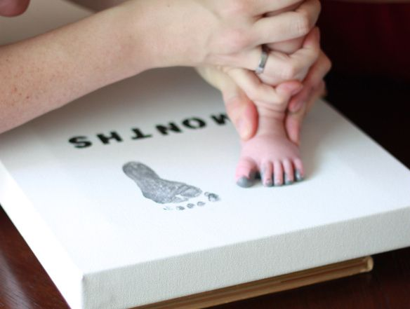 Baby footprint canvas. I'll do 3,6,9, &12 months!