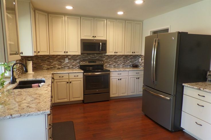 White cabinets, gray countertops, love the look of the matte slate appliances.