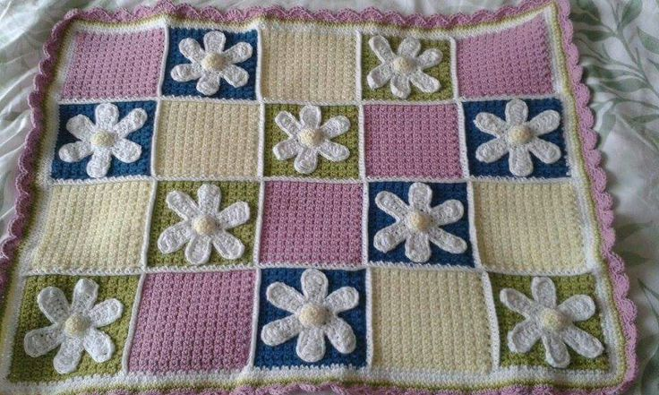 Daisy Afghan pattern by #RepeatCrafterMe. I thought the outside edge would get chewed (etc) so used pink instead of white!