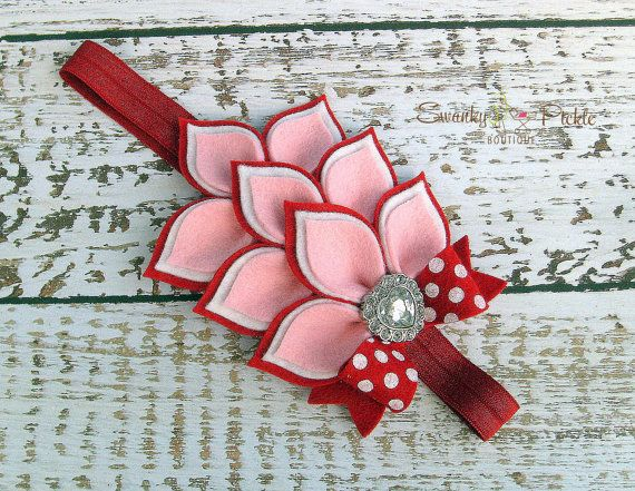 This Valentines theme headband consists of three rows of layered wool felt in red, pink and white. The flower pad measures approximately 5