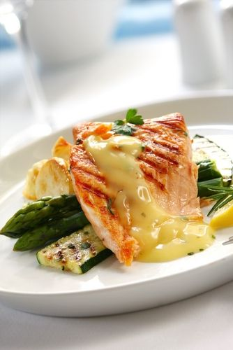 Grilled salmon with lemon and herb butter sauce.