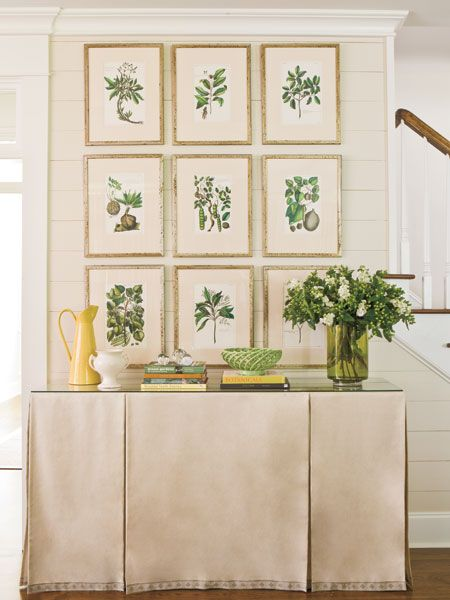 Friendly Foliage  A group of plant prints creates a focal point in this entryway. Complete the neat look with a few coffee table books and a large hurricane vase filled with fresh clippings. For added structure, try putting a pleated skirt over a console table.