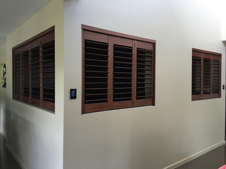 Custom timber plantation shutters to media room