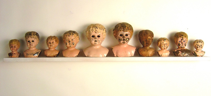 Antique pressed metal doll heads