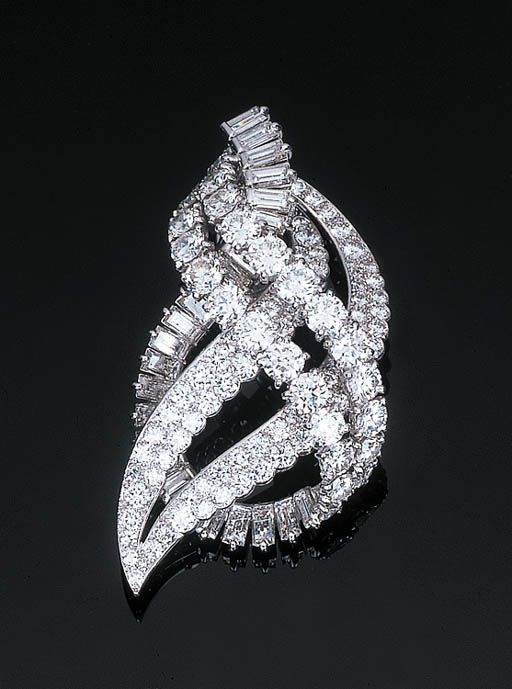 A Diamond Pendant Brooch by Cartier Of scrolled openwork design, set with four circular-cut diamond rows with a further scrolled baguette-cut diamond line, hidden pendant hook, with French assay and maker's marks, in a fitted red leather case, 5.5 cm long Signed Cartier, Paris, No. 012220