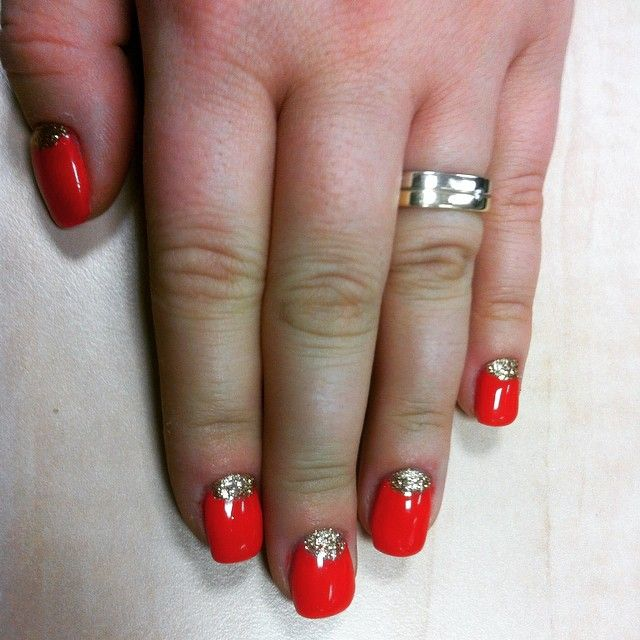 Red nails with golden details