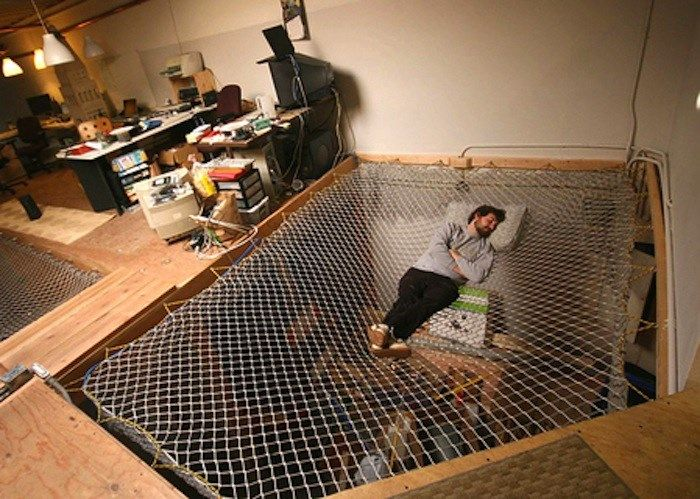 For the man cave with plenty of space, this huge built-in net hammock is where the gods wish they could nap.