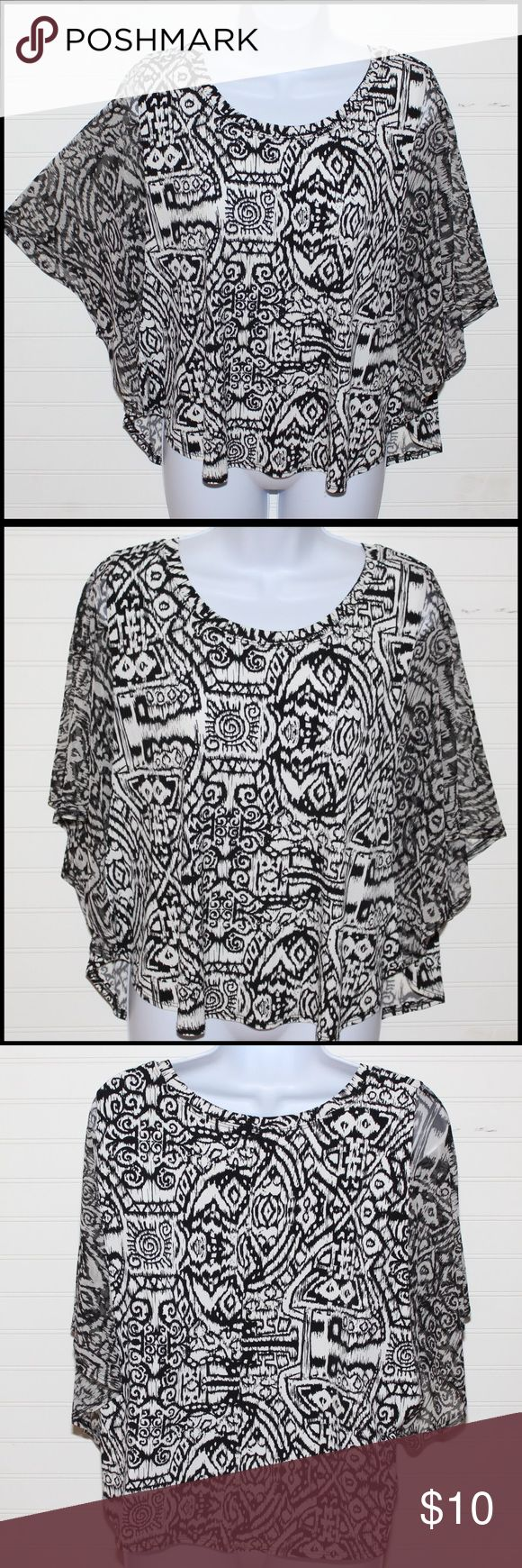 Black and white top with flared sleeves This top looks great on with batwing sleeves and a great print. Great with anything from shorts to jeans to skirts. Honestee Tops