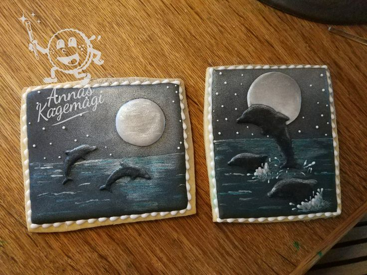 Dolphins playing at night on a sugarcookie