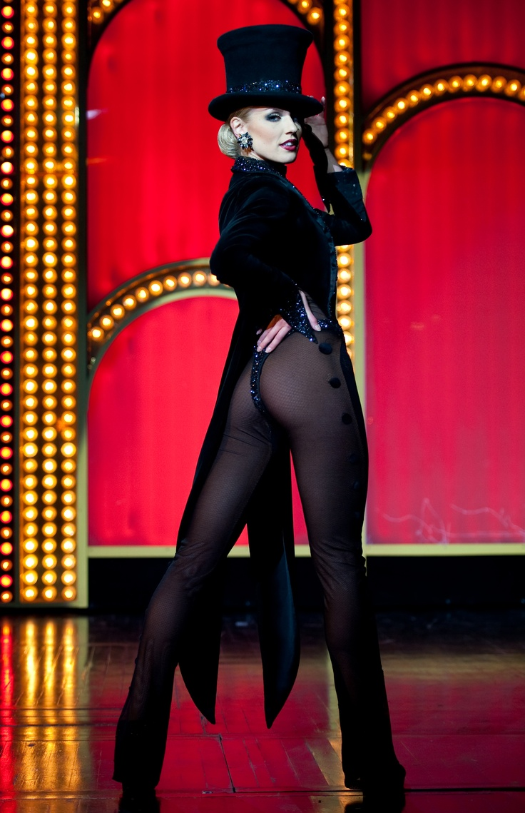 Lido de Paris - Carien Keiser  girl wears a tux (sorry Ms. Dietrich) ...Bending over to someone means mooning you rare end to others,isn`t it :)? Bowing is an attitude