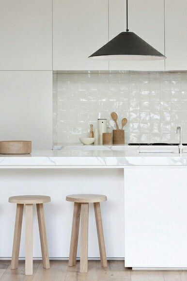 Simple white modern kitchen with high gloss white splash back.  good texture.