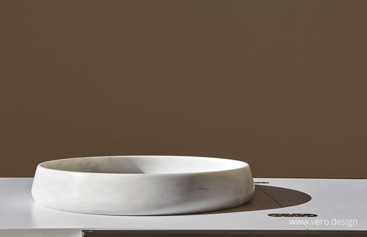 "TONDO UNO: ""Carrara is where Michelangelo came to source the marble for his masterpieces and (...).  Hand crafted by a master craftsman in Carrara, the Designer has sought to bring a sense of serenity and timelessness to the enduring beauty of marble.  Available in various sizes, the pieces can be used collectively or individually, enhancing living spaces by providing a sculptural element""."