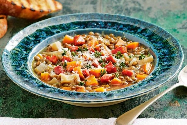 Create a hearty family meal with Curtis Stone's comforting lentil soup topped with crispy pancetta, grated parmesan and garlicky croutons.